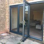 sliding folding doors in grey aluminium