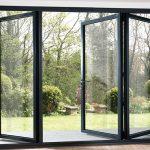 Bi-folding doors in grey aluminum