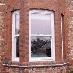 SIMPLE SASH WINDOW UNIT IN A BAY STYLE ON BRICK HOUSE