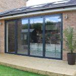 Grey 4 panel external aluminium bifold doors on a west london home