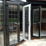 BLLACK A RATED FRENCH UPVC DOORS WITH GEORGIAN BAR OPEN OUTWARDS