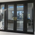 black french doors with side panels