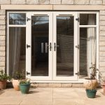 upvc french doors in white with side windows either side that open