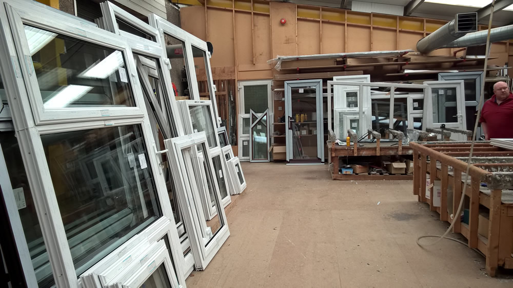 Newly manufactured windows lined up against the wall