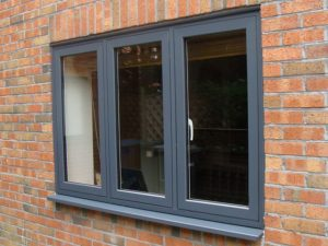 grey upvc windows closed on brick wall