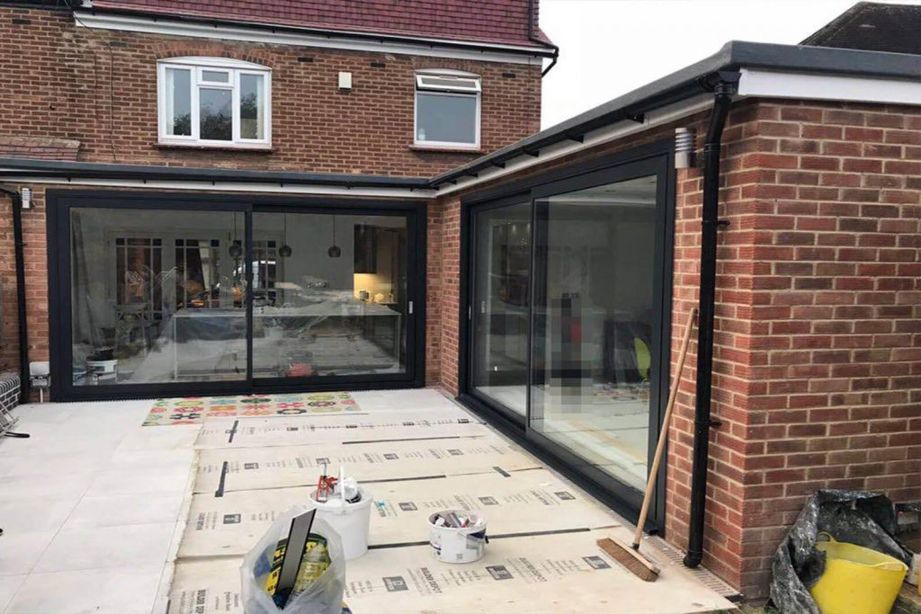 chelsea home showing off sliding doors in garden room