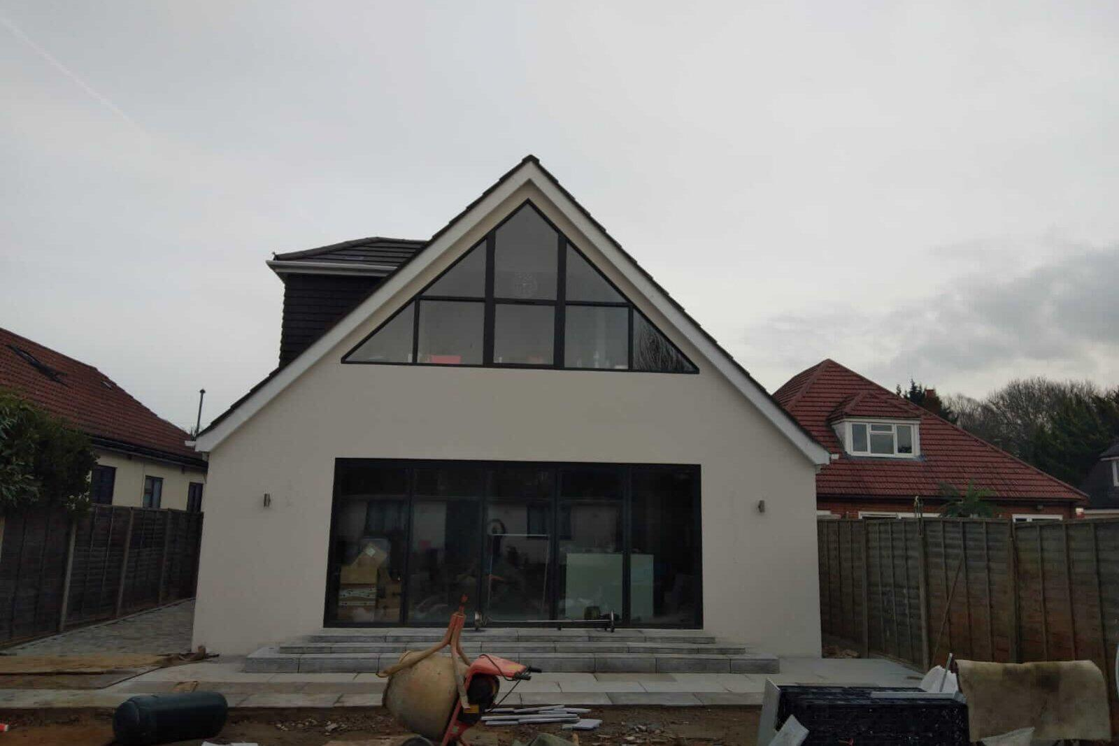 Rear elevation of shaped window home