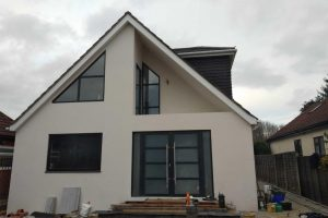 Shaped windows and composite front door on uxbridge home
