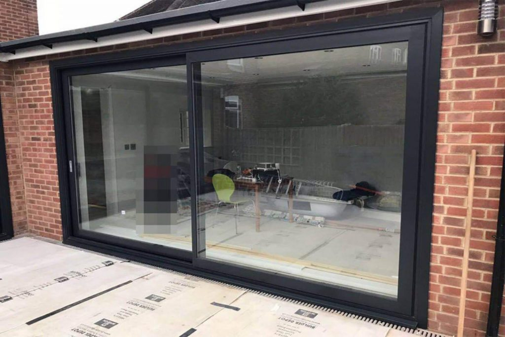 Large black aluminium sliding doors fitted in chelsea and kensington home