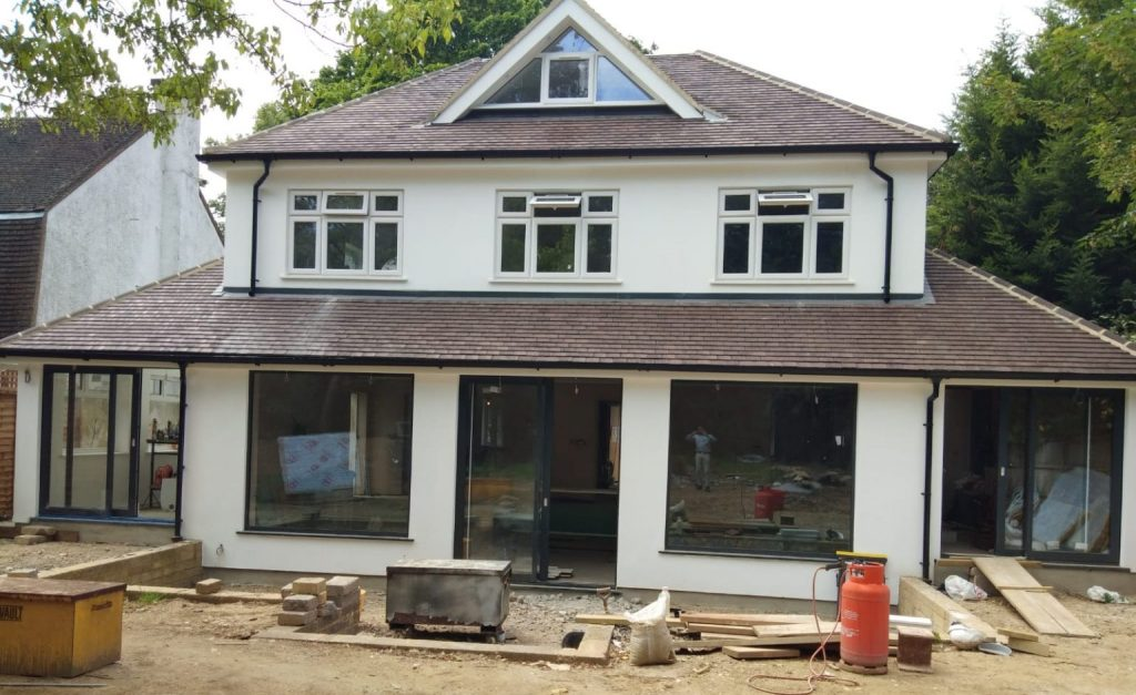 Custopmer home in gerrards cross with shaped windows, casement windows and sliding doors