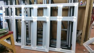 newly manufactured aluminium frames for windows in ealing warehouse