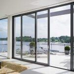 Grey sliding doors with thin frame at location E9 5EN rothbeck road