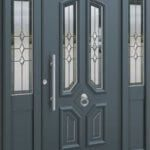 Grey Front door inaluminum with a wooden look finish belonging to east St Awdry's Rd, Barking IG11 7QB