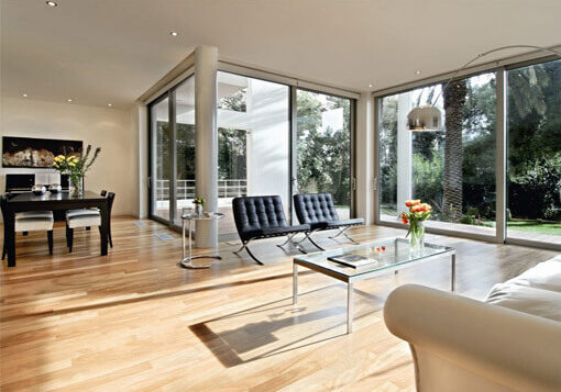 living room area with aluminium windows and doors in the background