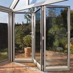Aluminium bifold doors half opened at ec1 post code london