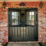 upvc double french doors in black with gold handles , top half open for display
